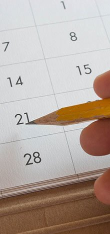 Penciling in an event on the calendar